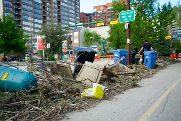 Collected debris on the side of Elbow Drive and 4th Street SW Calgary Flood