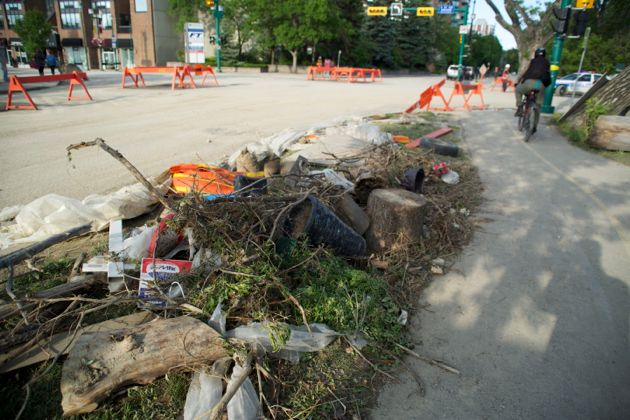 As clean up crews work overtime this shot shows Elbow Drive Calgary Flood Debris collected