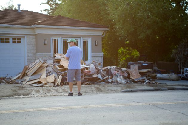 Debris filled yard of a local resident of Roxboro - Calgary Flood Aftermath
