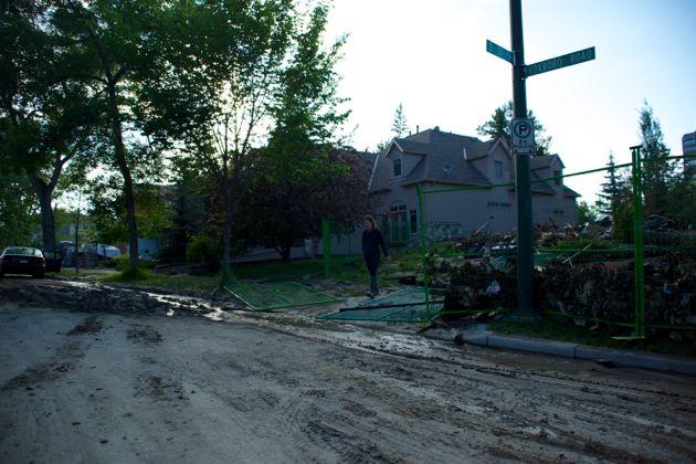 Local Roxboro resident assessing flood damage to her home - Calgary Flood
