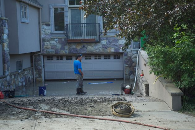 Clean up crews draining water from a local resident of Roxboro along the river - Calgary Flood