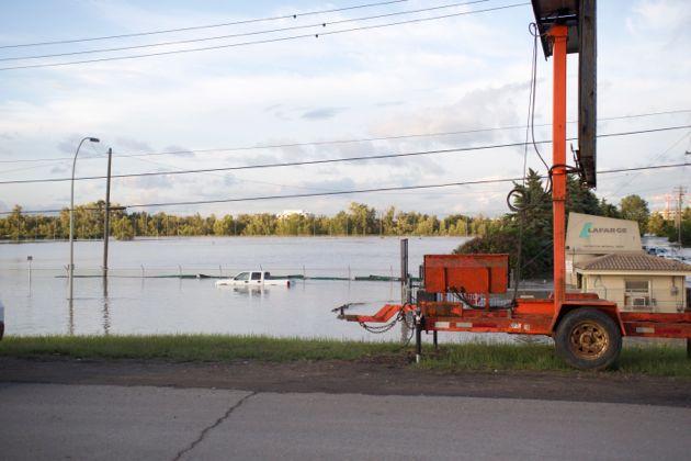 Calgary Flood Photo - Lafarge Truck Under Water